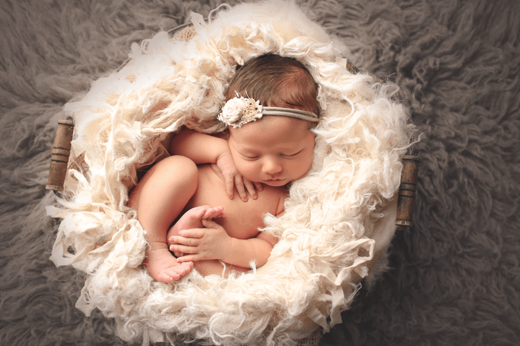 newborn-girl-in-white-nest