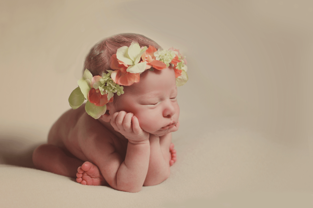 New Orleans newborn girl froggy pose profile