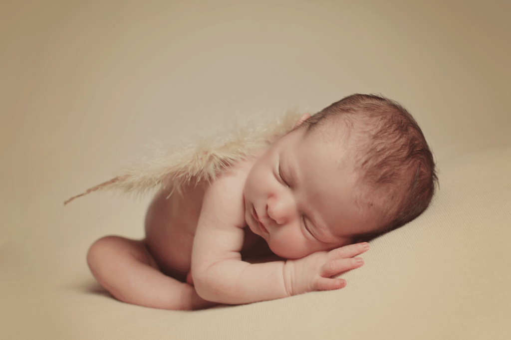 Newborn girl with angel wings