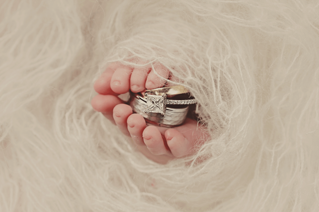 newborn feet and wedding rings
