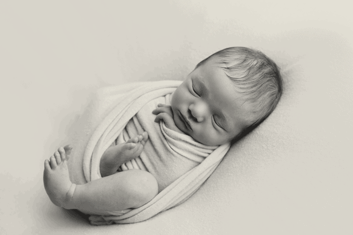 newborn boy wrapped pose
