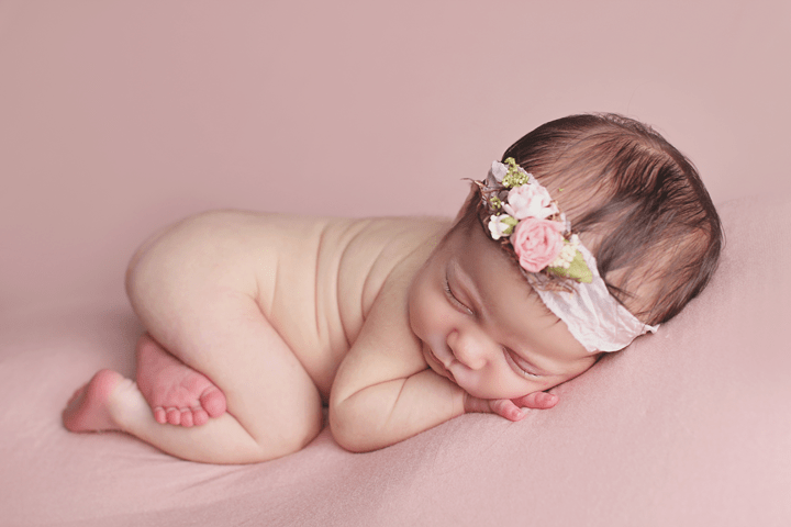 Newborn girl side pose