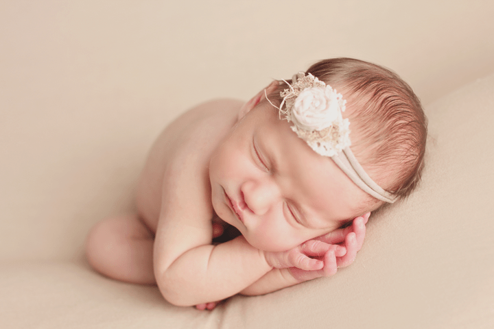 newborn-girl-on-neutral-bac
