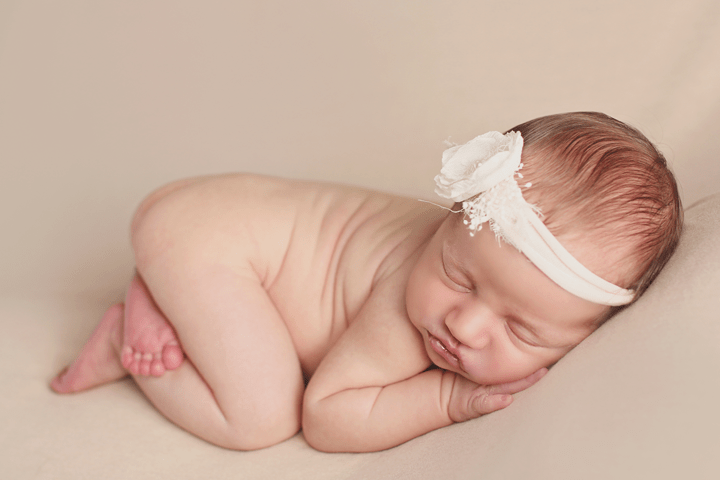 newborn-girl-side-pose