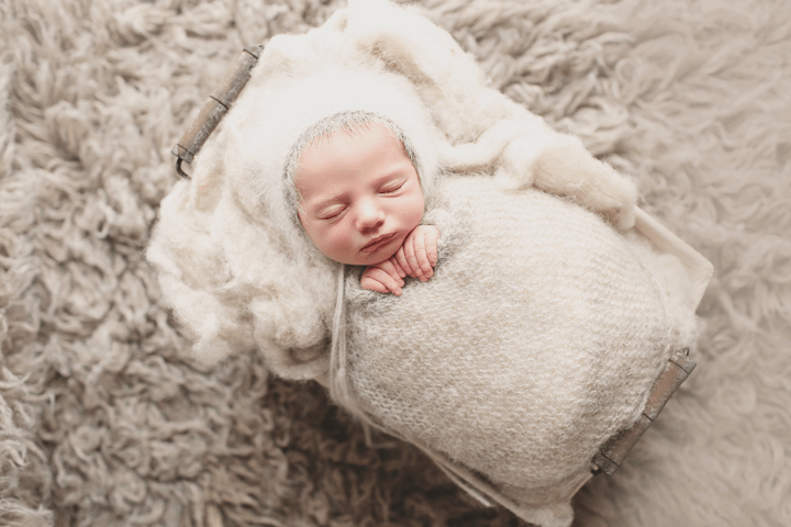 newborn-boy-in-gray-bonnet