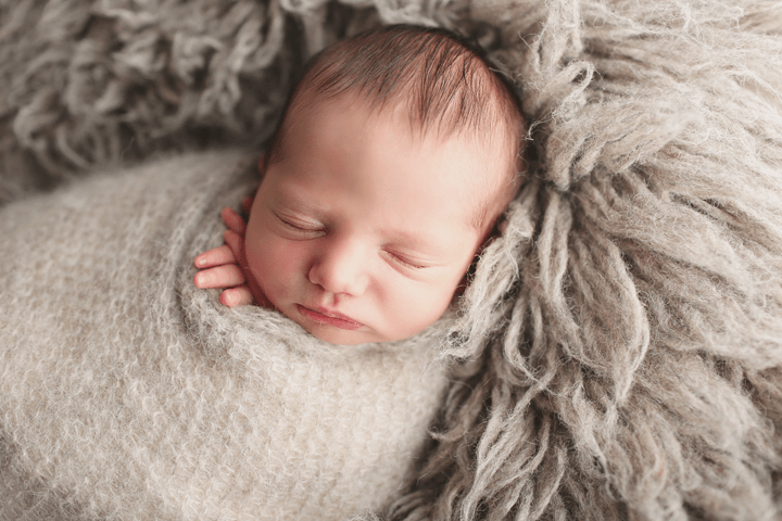 newborn-boy-in-gray-wrap