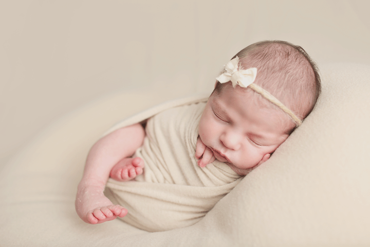Newborn-girl-in-wrap