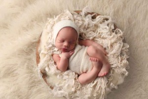 newborn-boy-in-wooden-bowl