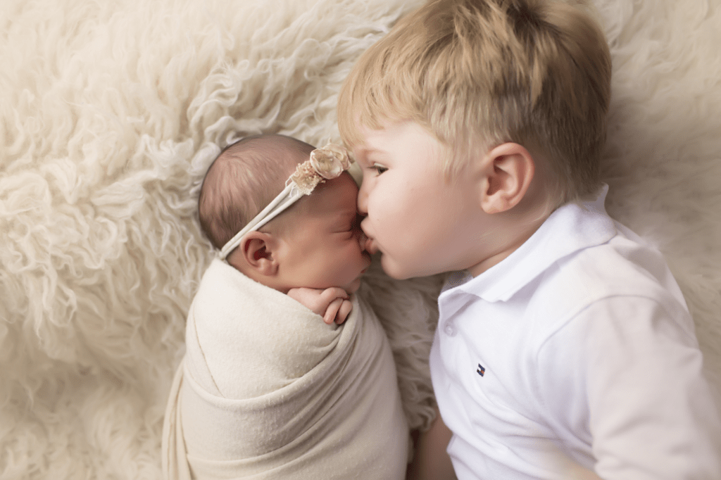 big-brother-kissing-newborn