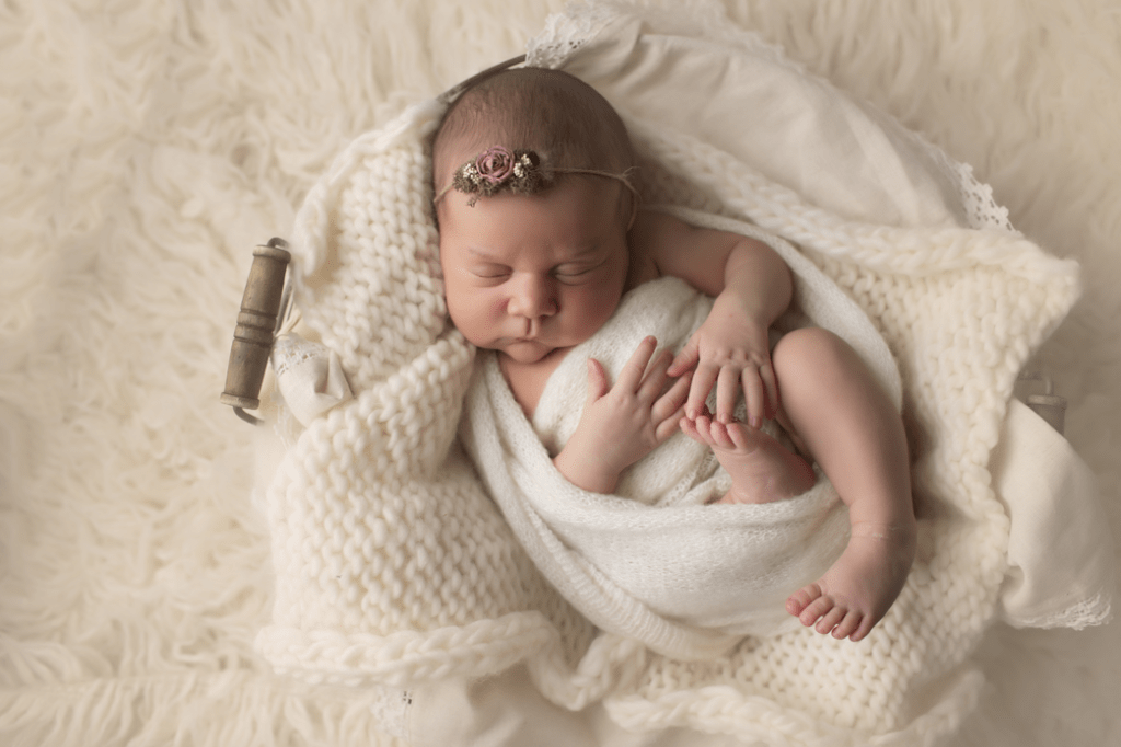 newborn-girl-in-cream-and-p
