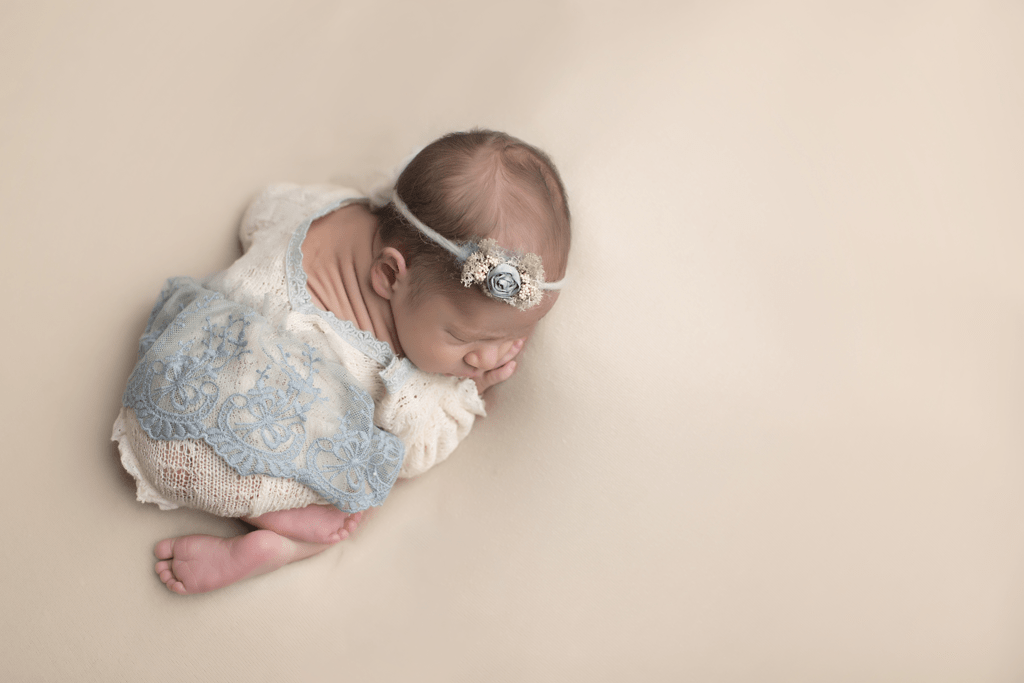 Newborn-girl-in-blue-outfit