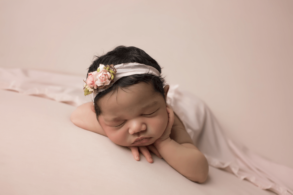 newborn-girl-on-blush-backd