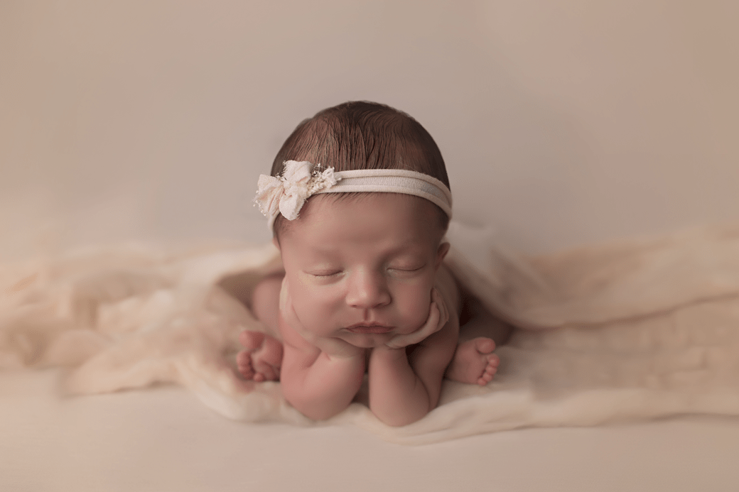 newborn-girl-on-peach-fluff