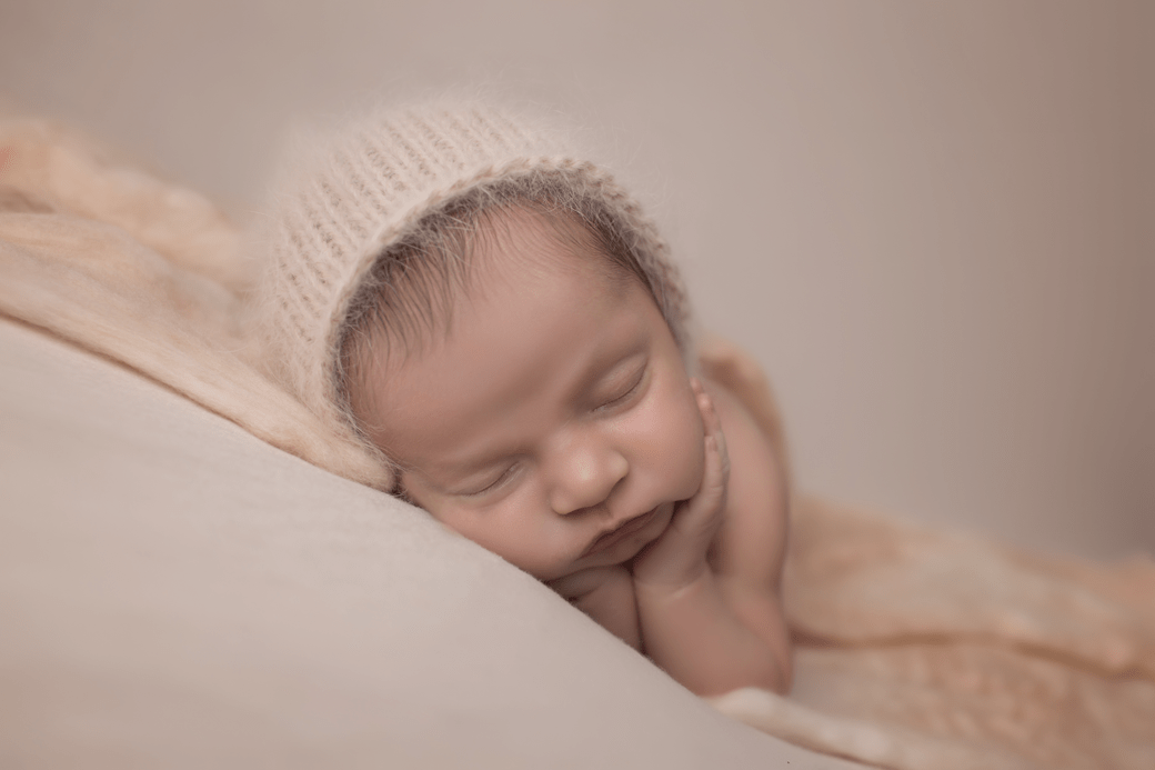 baby-girl-in-fuzzy-bonnet