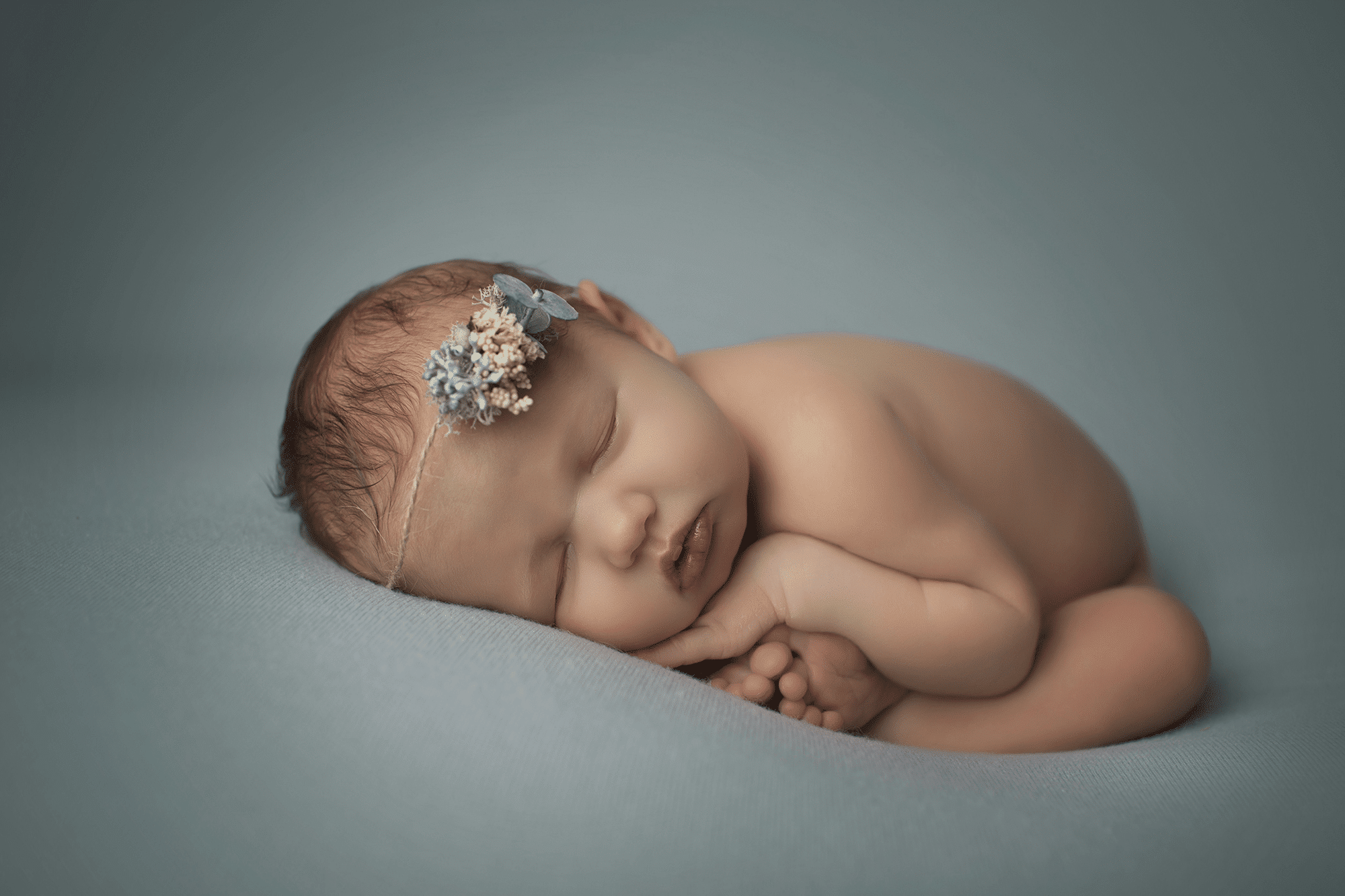 newborn-baby-girl-on-soft-b