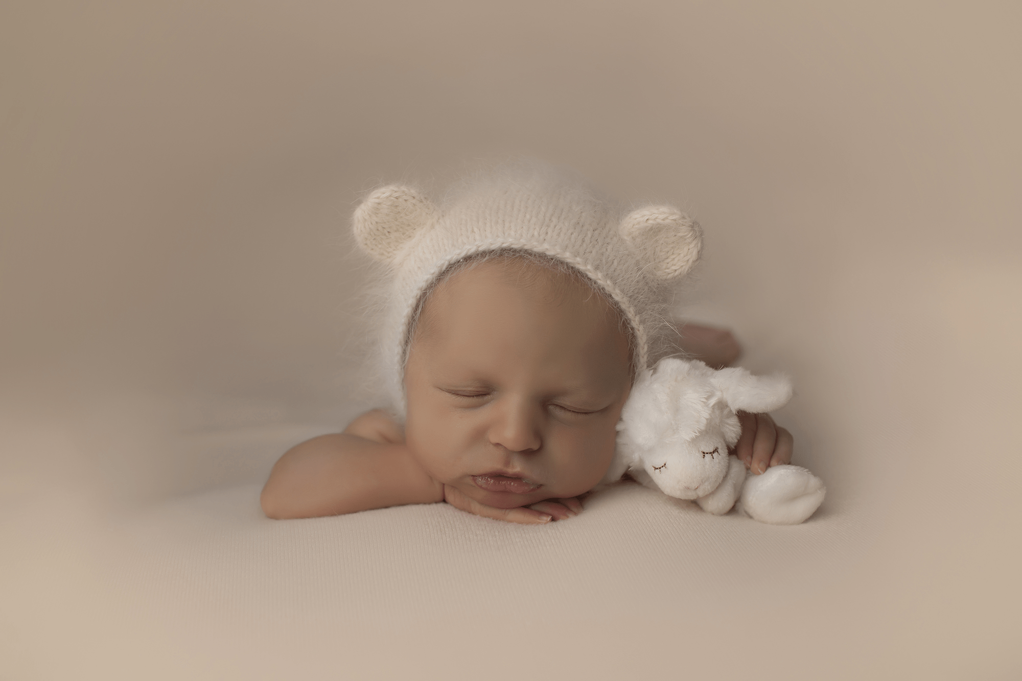newborn-girl-in-bear-bonnet