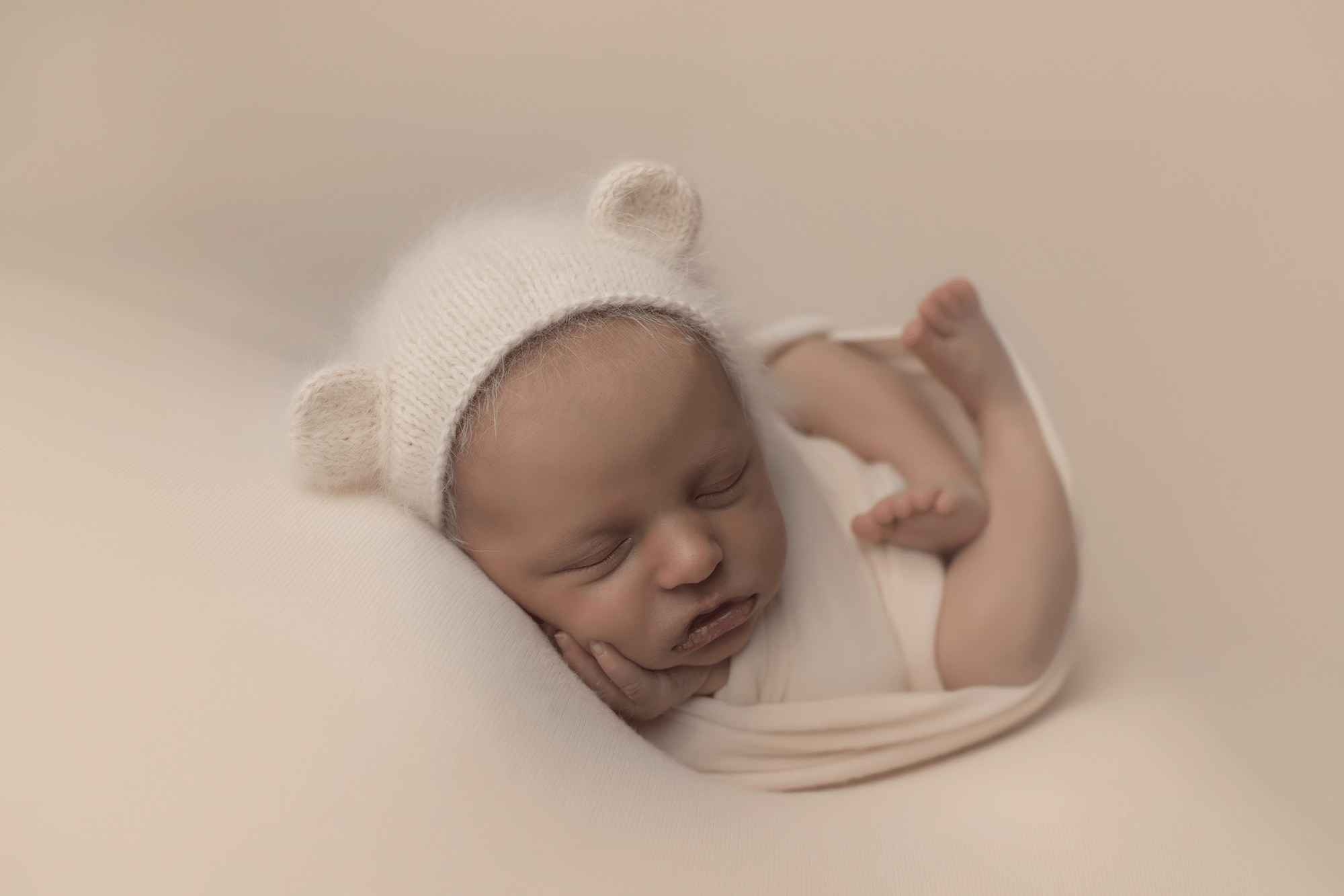 newborn-girl-in-cream-wrap