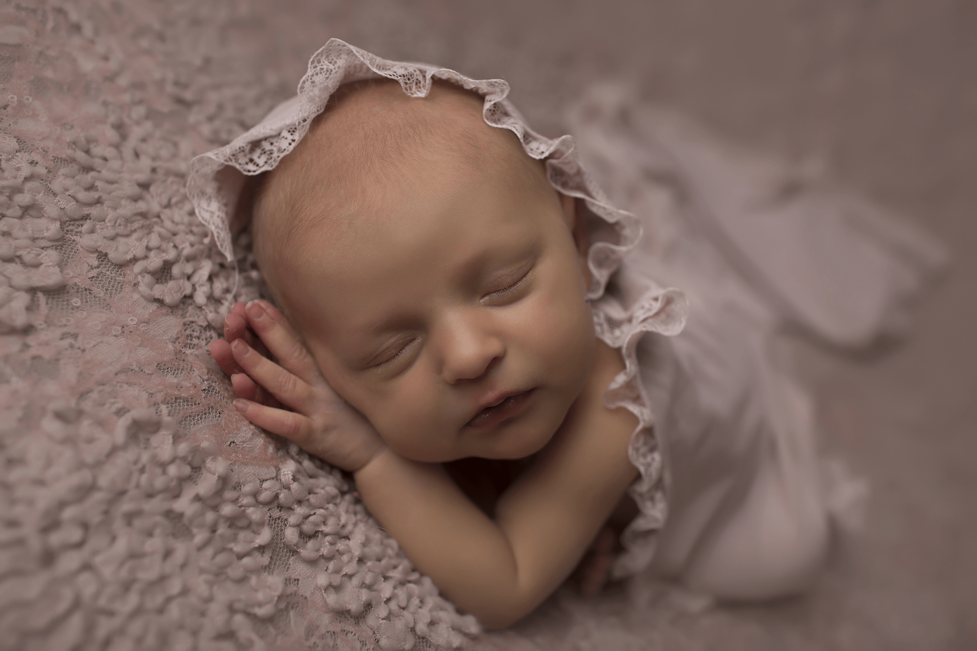 newborn-girl-on-mauve-backd