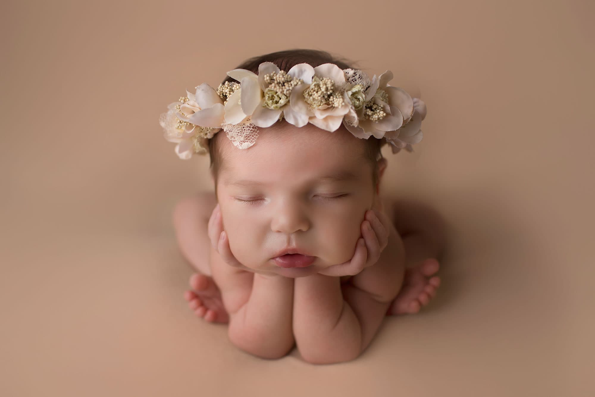 newborn-girl-froggy-pose-with-ivy-and-nell-crown