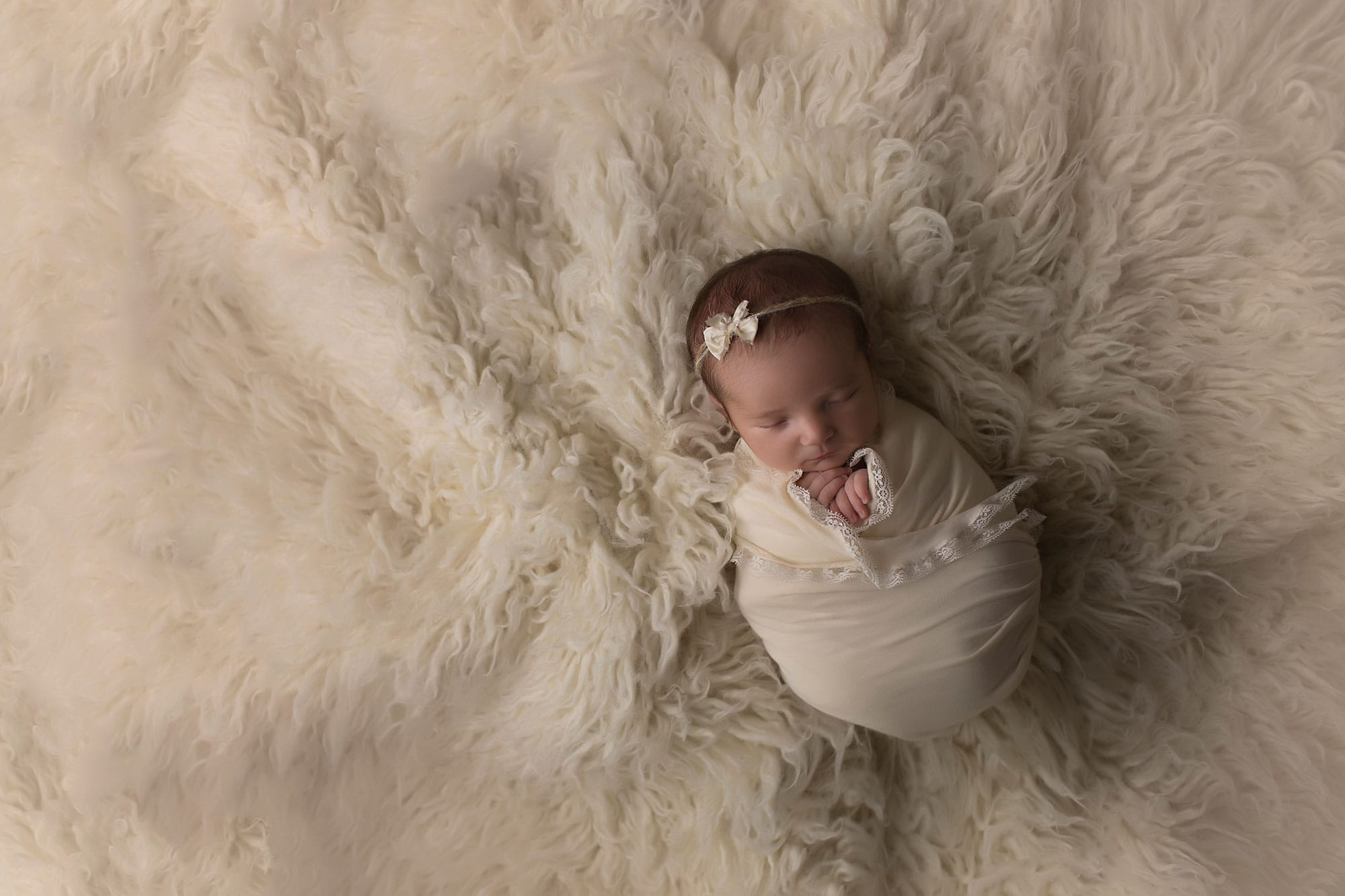 newborn-girl-in-cream