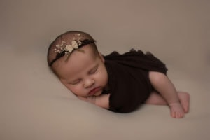 newborn-girl-in-side-pose