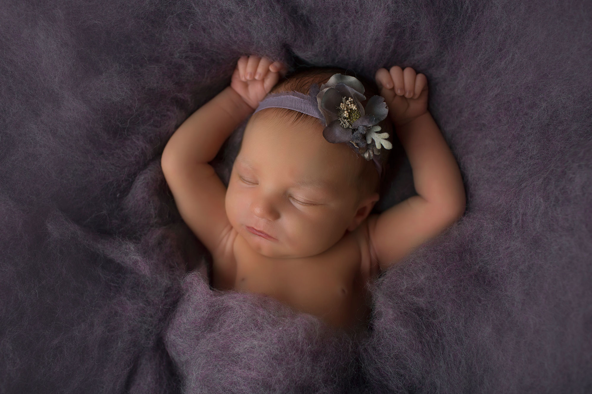beautiful-newborn-girl-on-purple-fluff