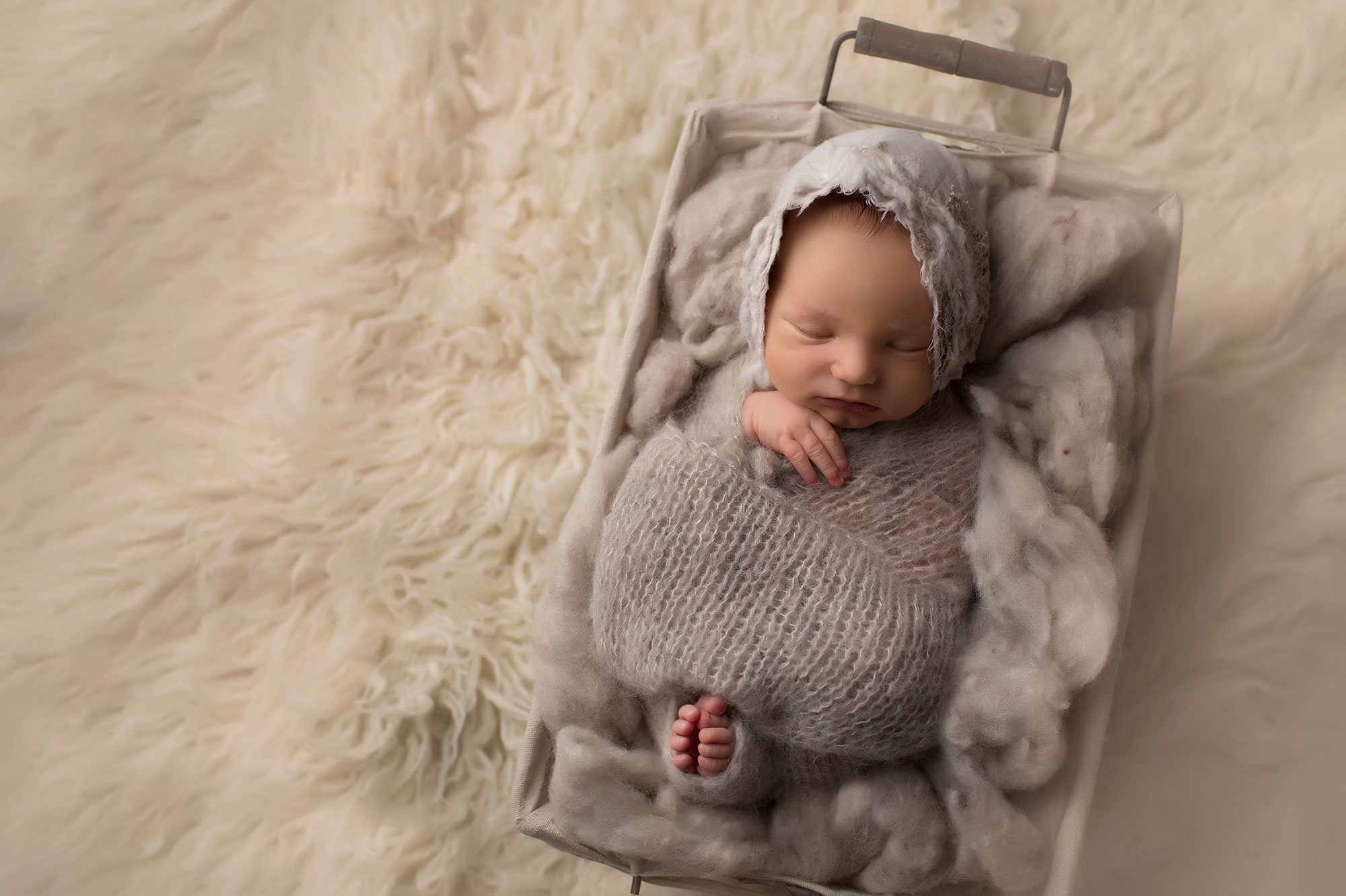 newborn-girl-in-gray-wrap-and-bonnetAda Day 4 {Madisonville newborn photographer}
