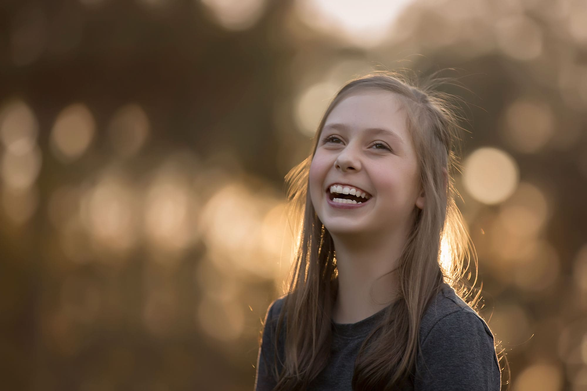 Girl smiling at sunset