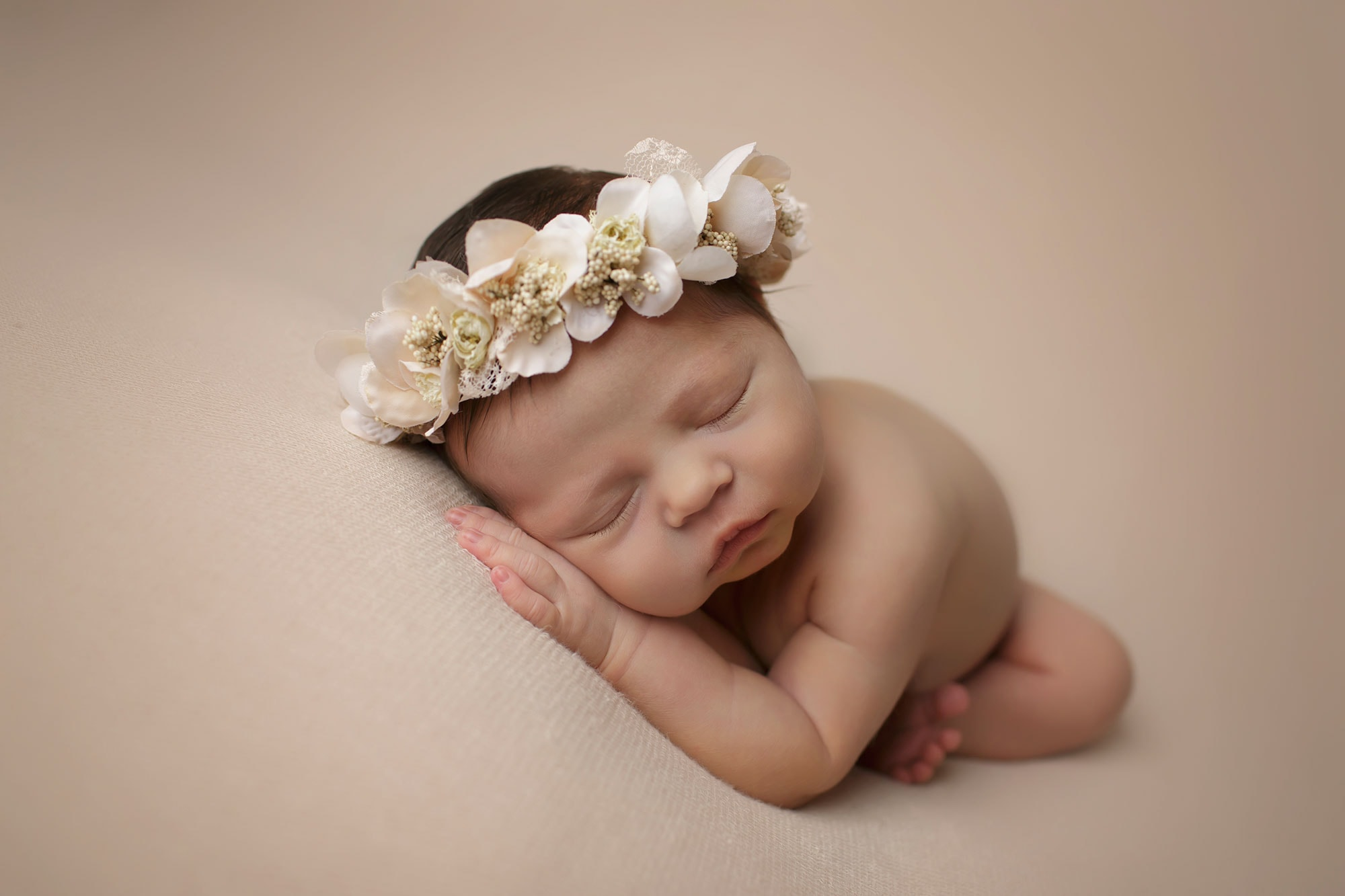 newborn girl wearing flower crown