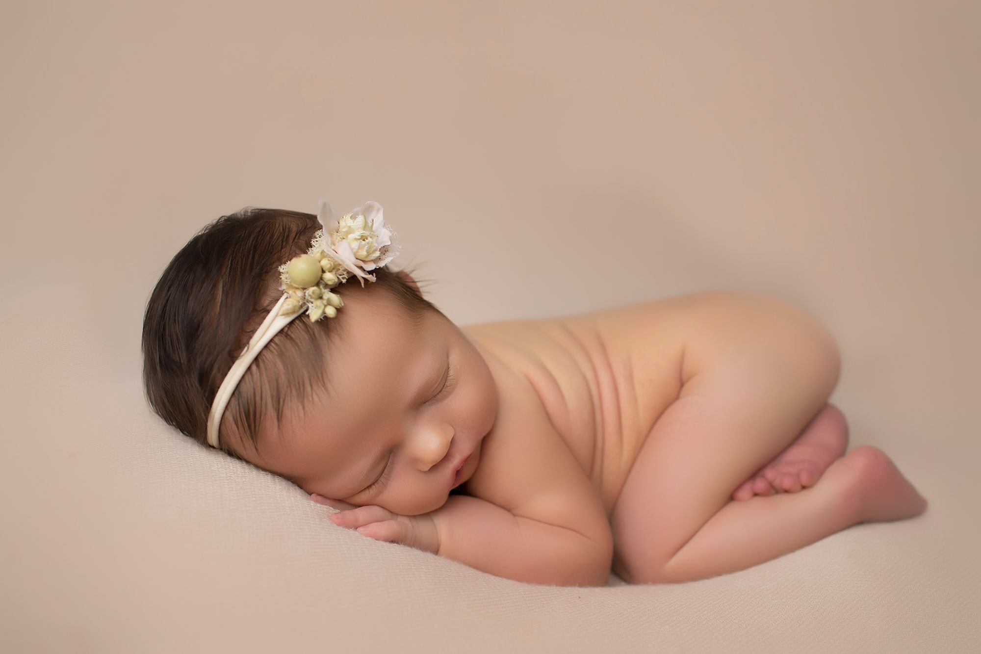 newborn girl in tushy up pose