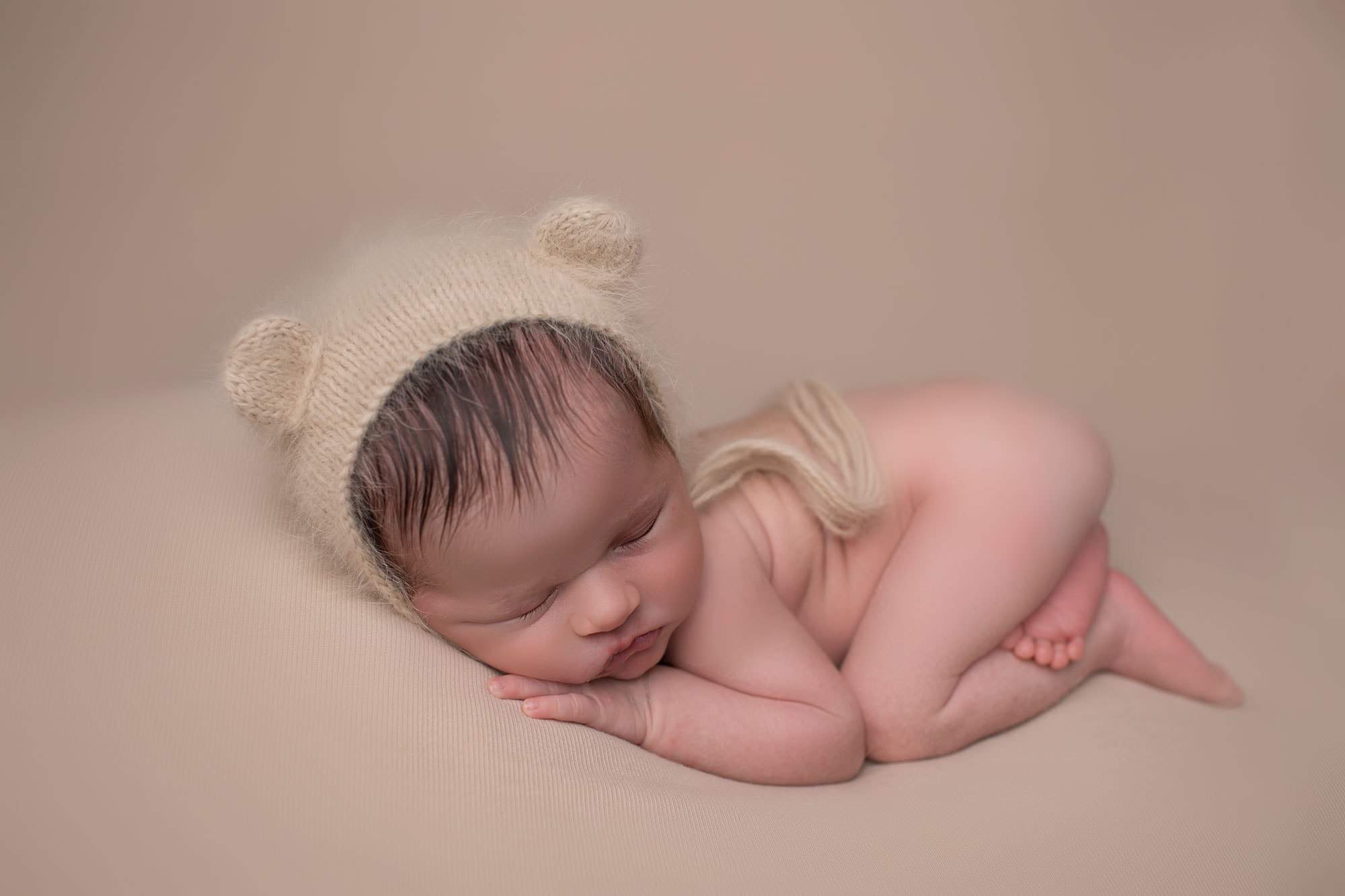 newborn boy in bear hat