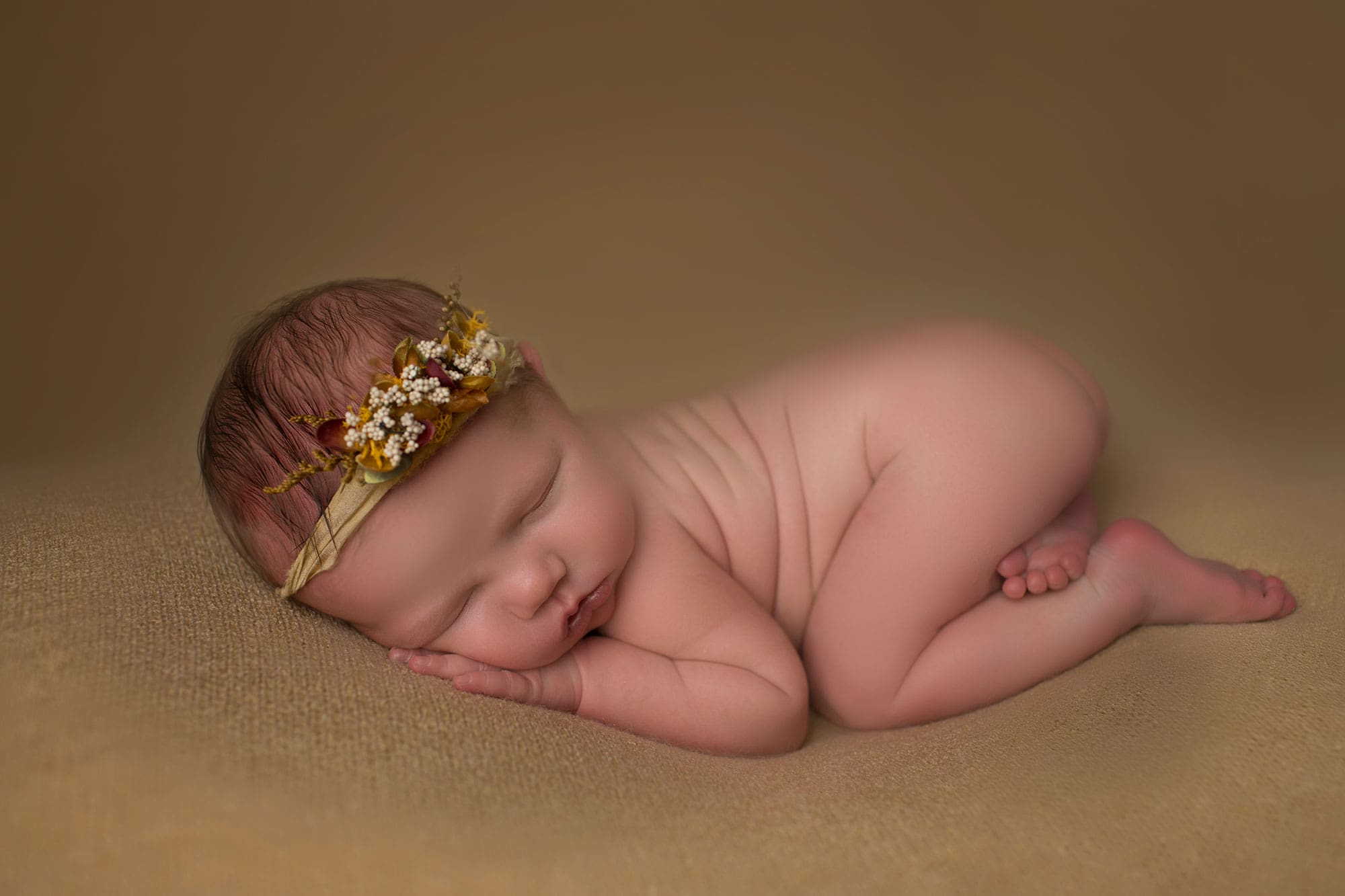 baby girl on wheat backdrop