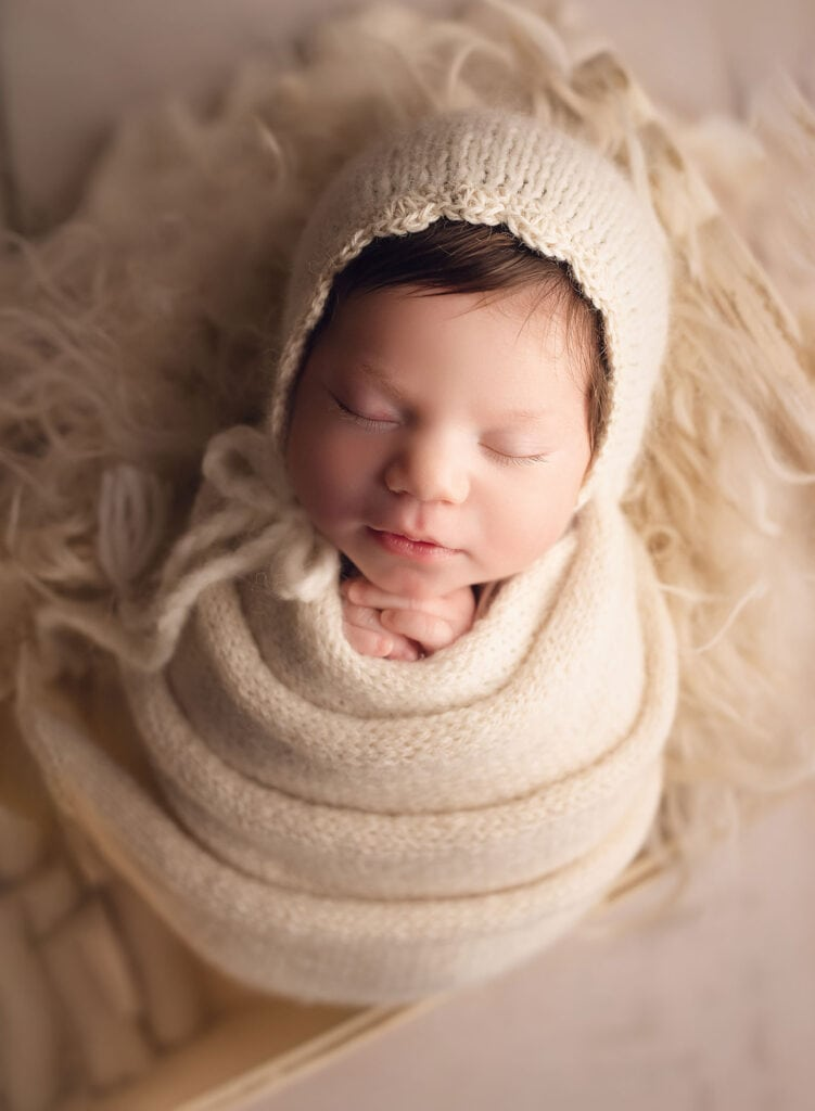 newborn girl in all cream set up