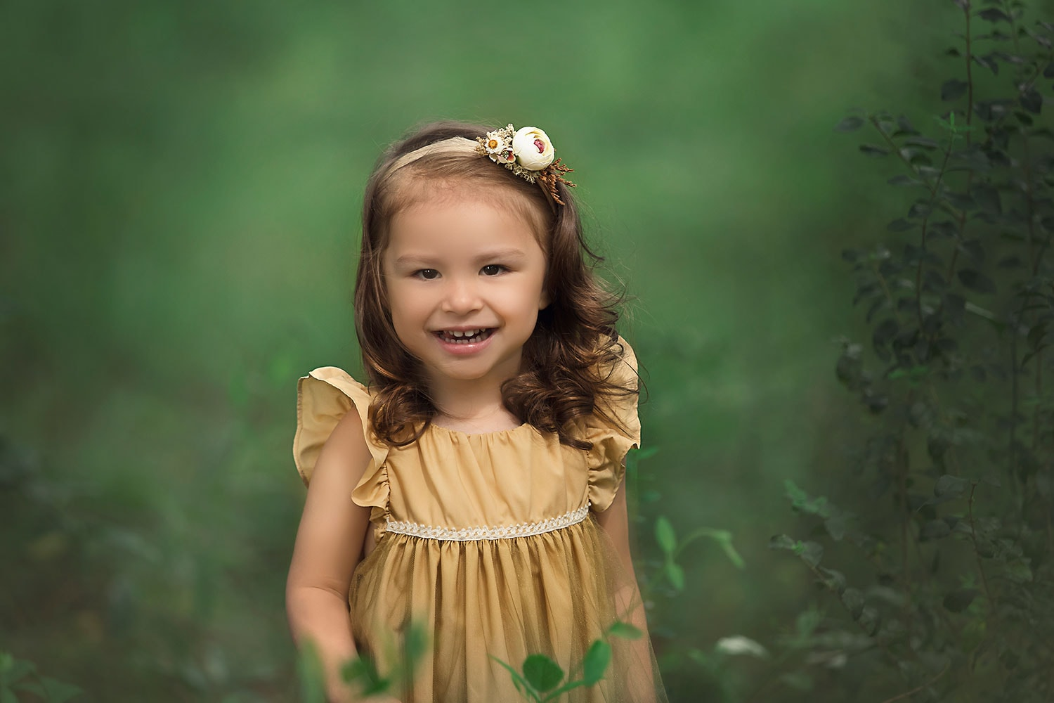 Close up of 2 year old in gold dress by Annie Whitaker Photography