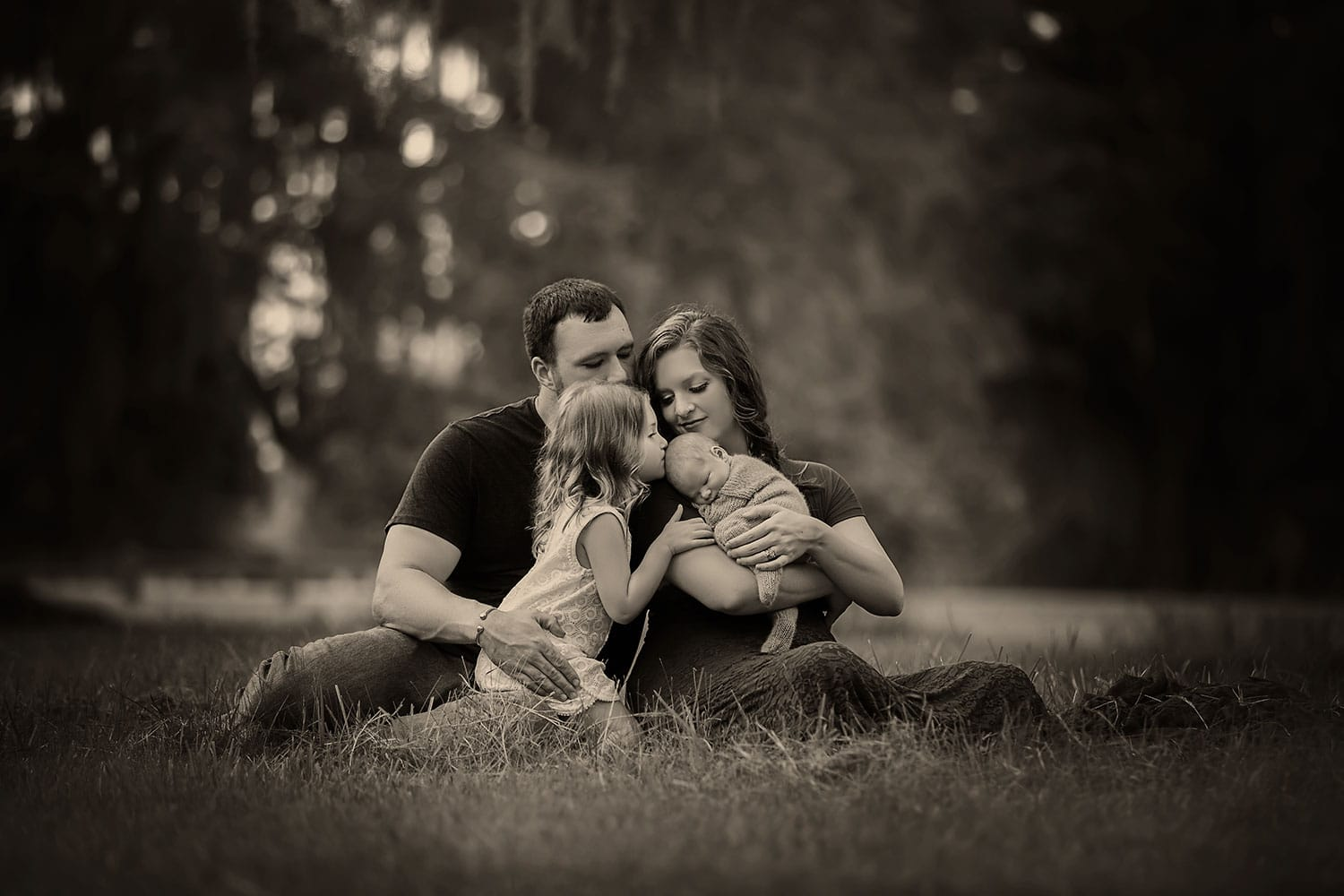 Outdoor family photo with newborn by Annie Whitaker Photography