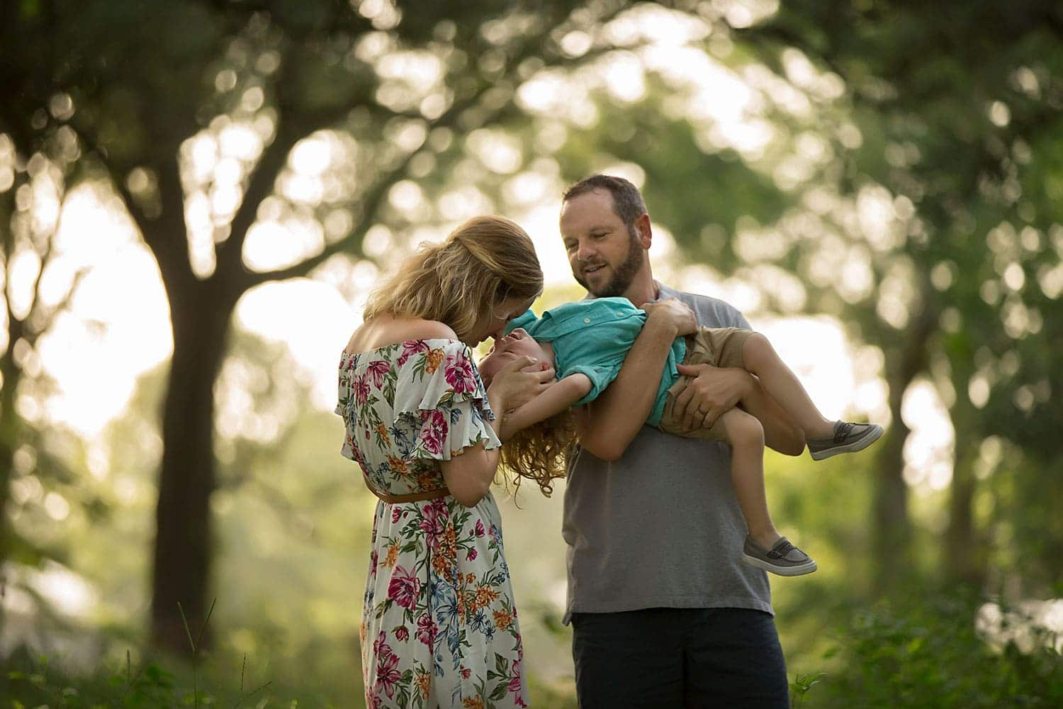 Mom and dad playing with son by Annie Whitaker Photography