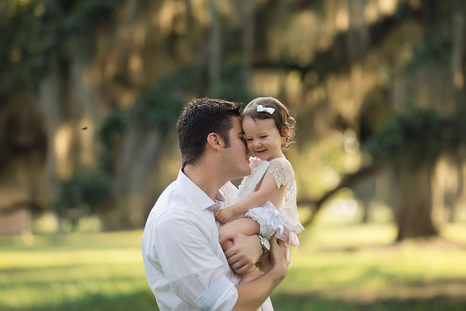 Dad snuggling baby girl by Annie Whitaker Photography