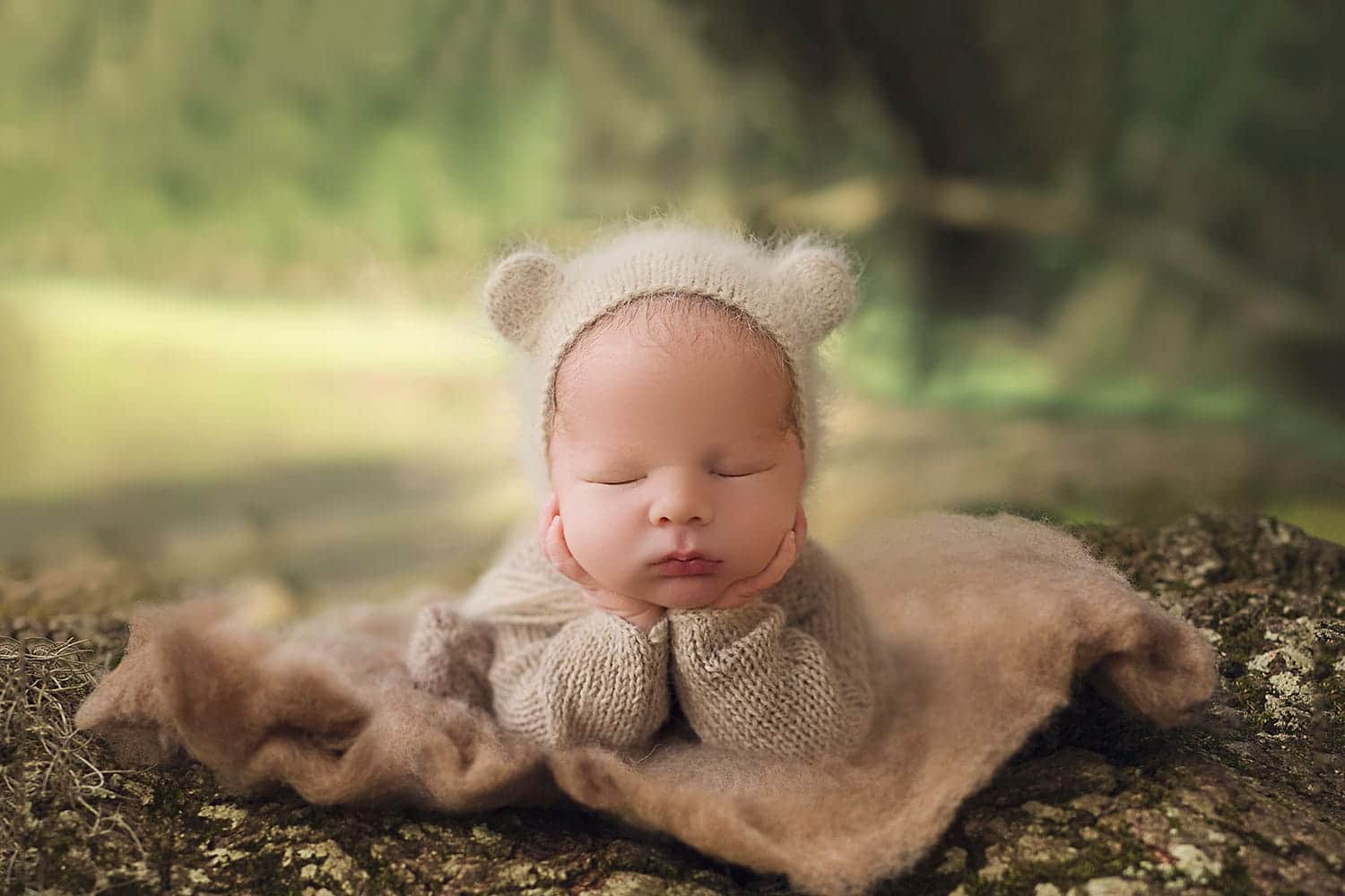 Baby in froggy pose on tree roots by Annie Whitaker Photography