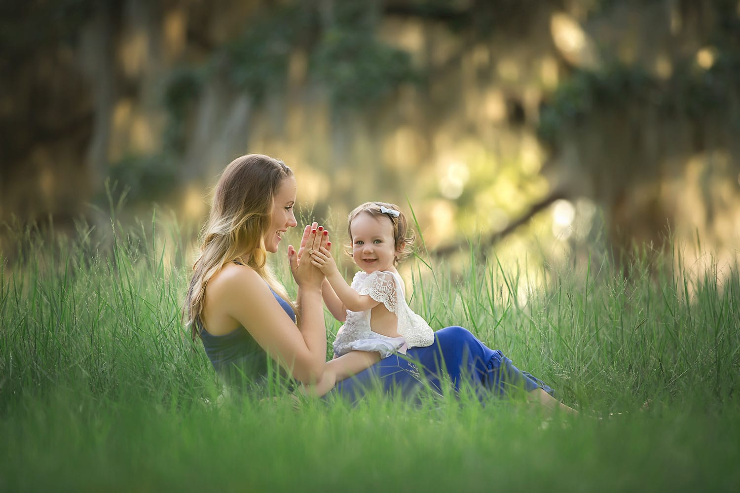 Mother and daughter playing patty cake by Annie Whitaker Photography