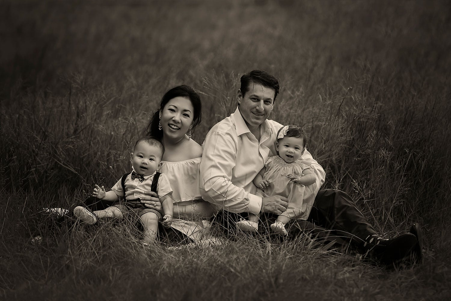 black and white family photo with one year old twins by Annie Whitaker Photography