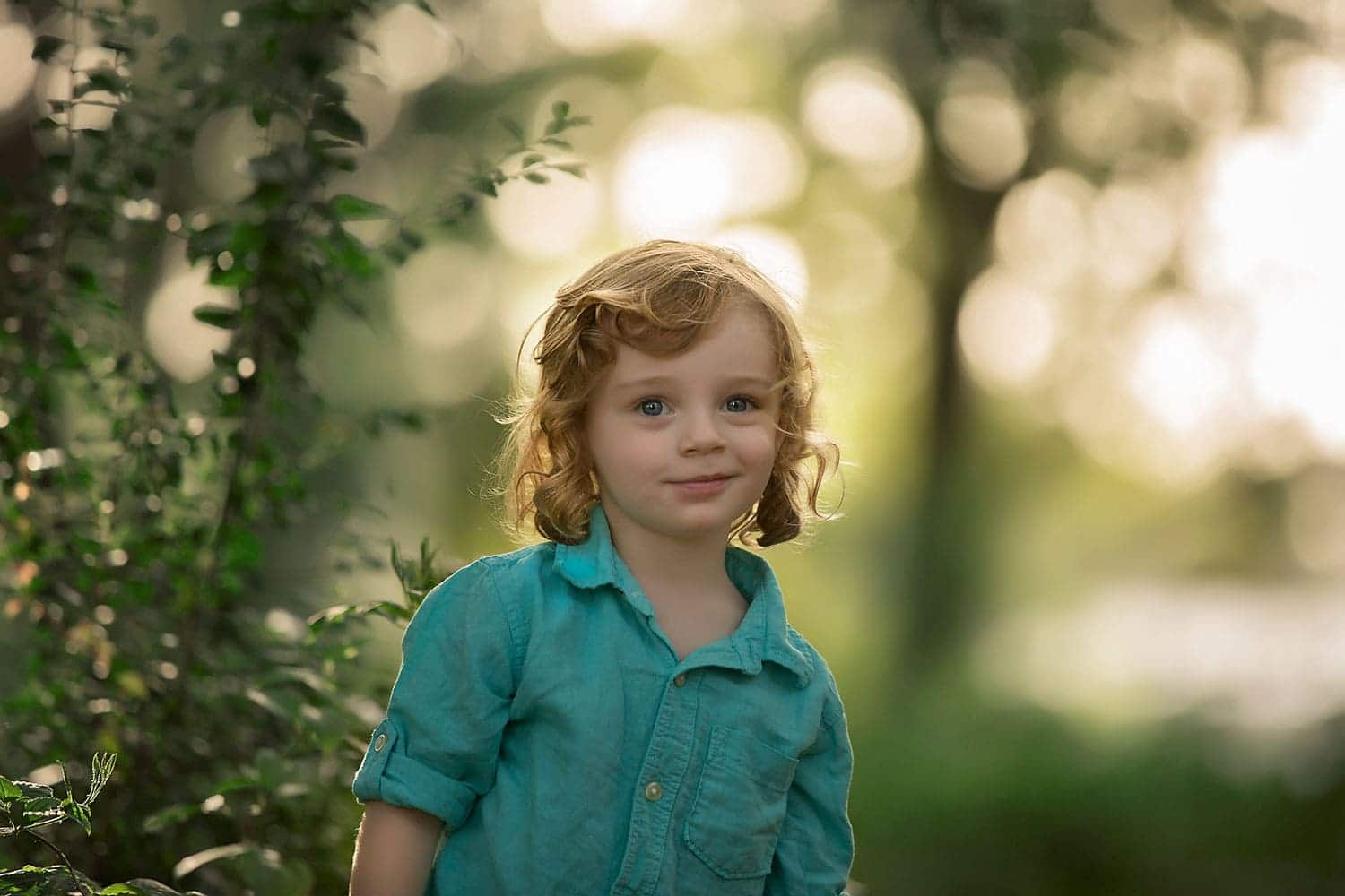 Little boy with blond curls by Annie Whitaker Photography