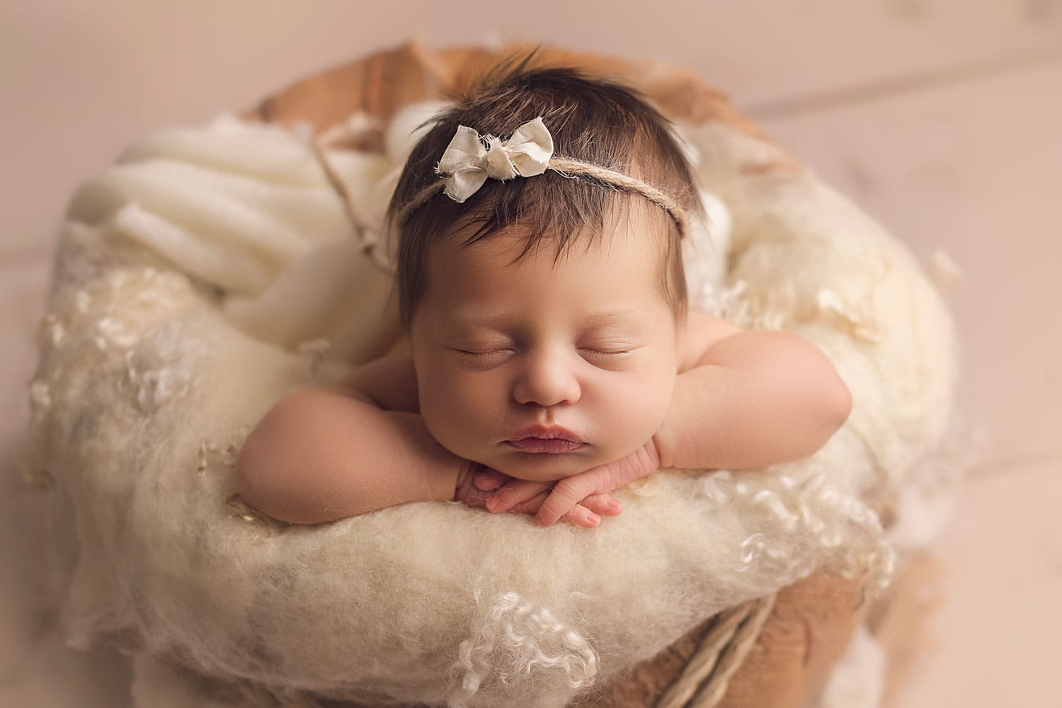 Baby girl in basket by Annie Whitaker Photography