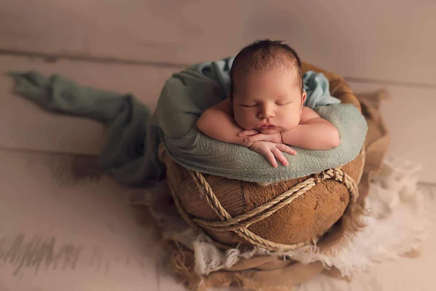 baby boy in basket by annie Whitaker Photography