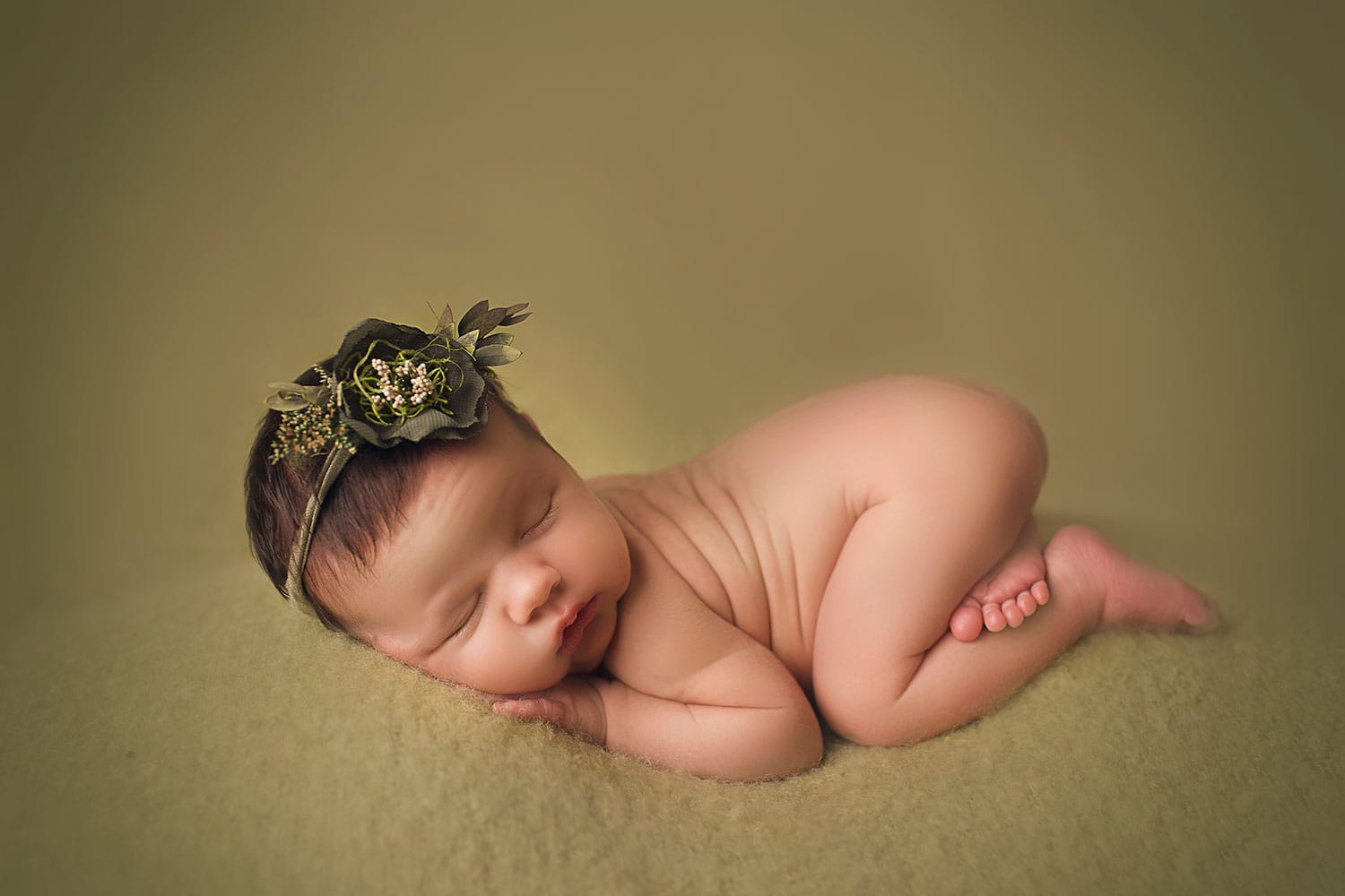 sweet baby on green by Annie Whitaker Photography