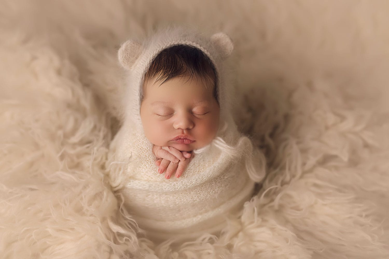 newborn baby in bear bonnet by Annie Whitaker Photography