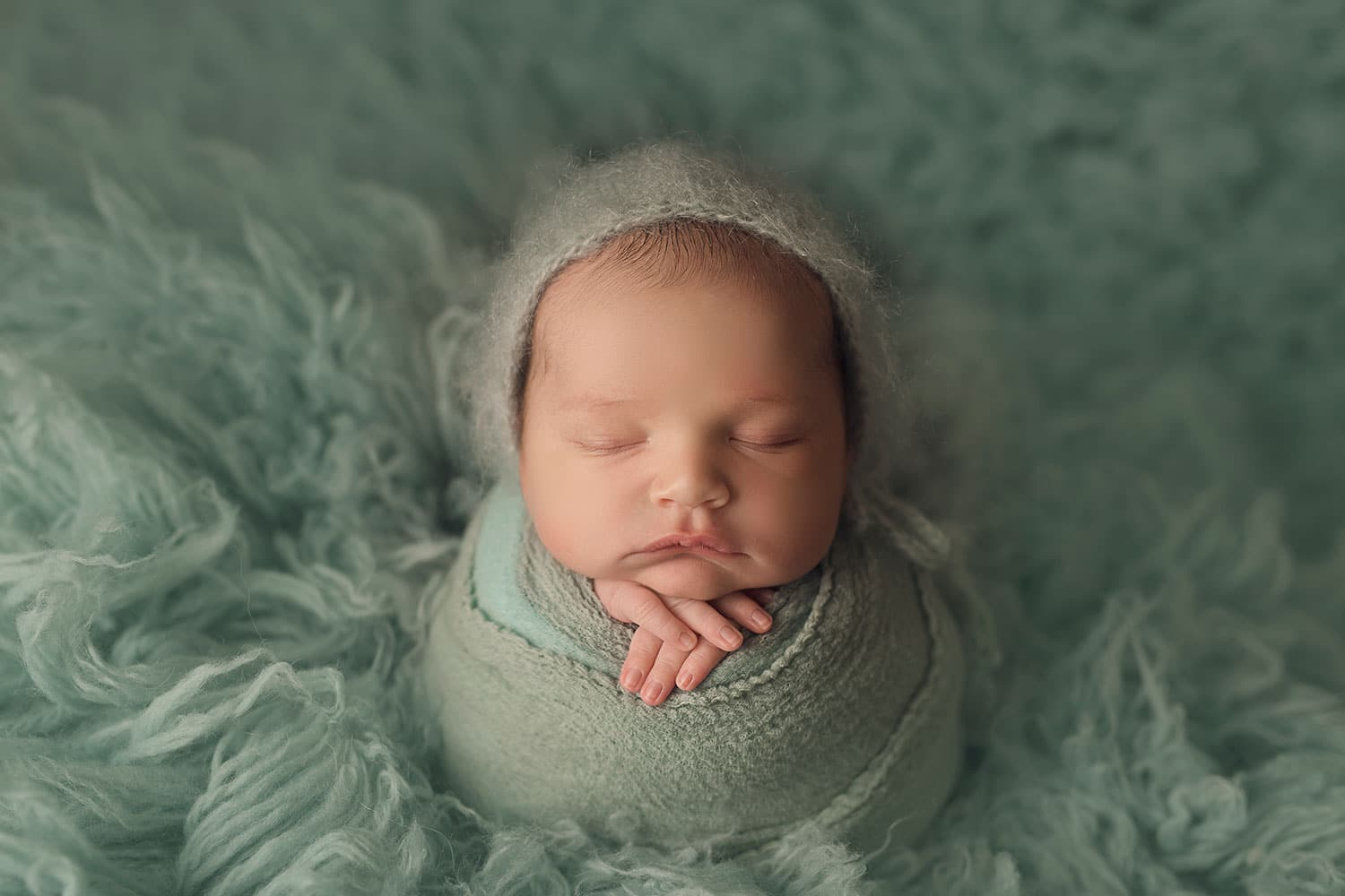 Baby boy in blue by Annie Whitaker Photography
