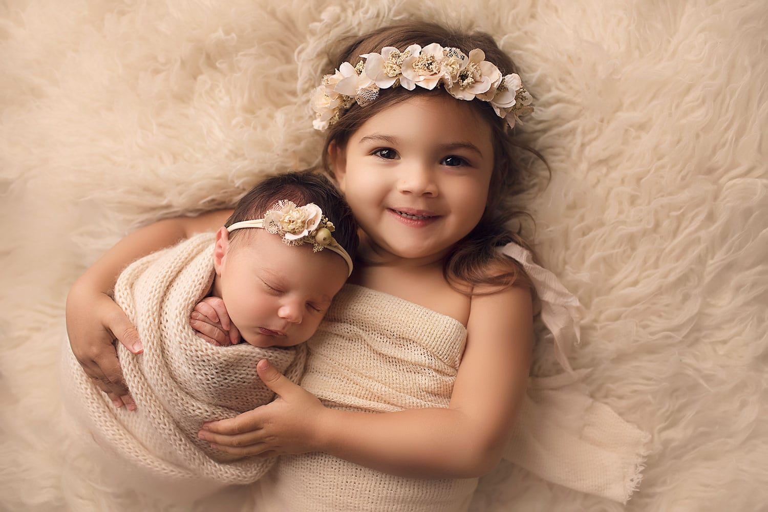 Sisters hugging by Annie Whitaker Photography