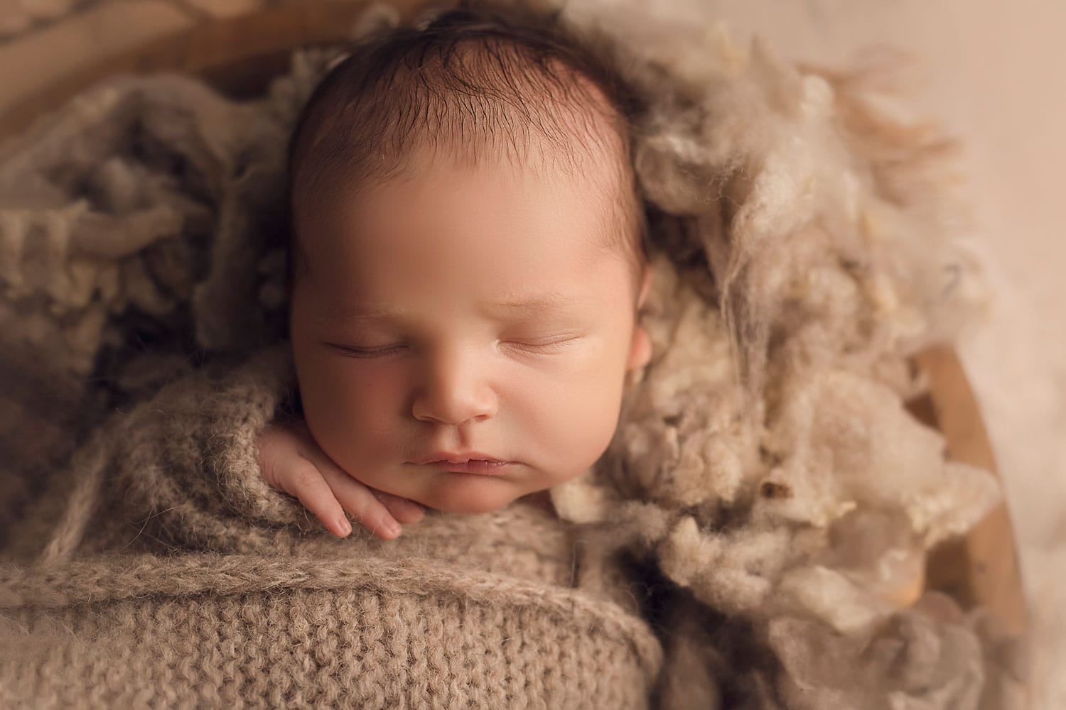 brown-haired baby boy in tan wrap by annie Whitaker Photography