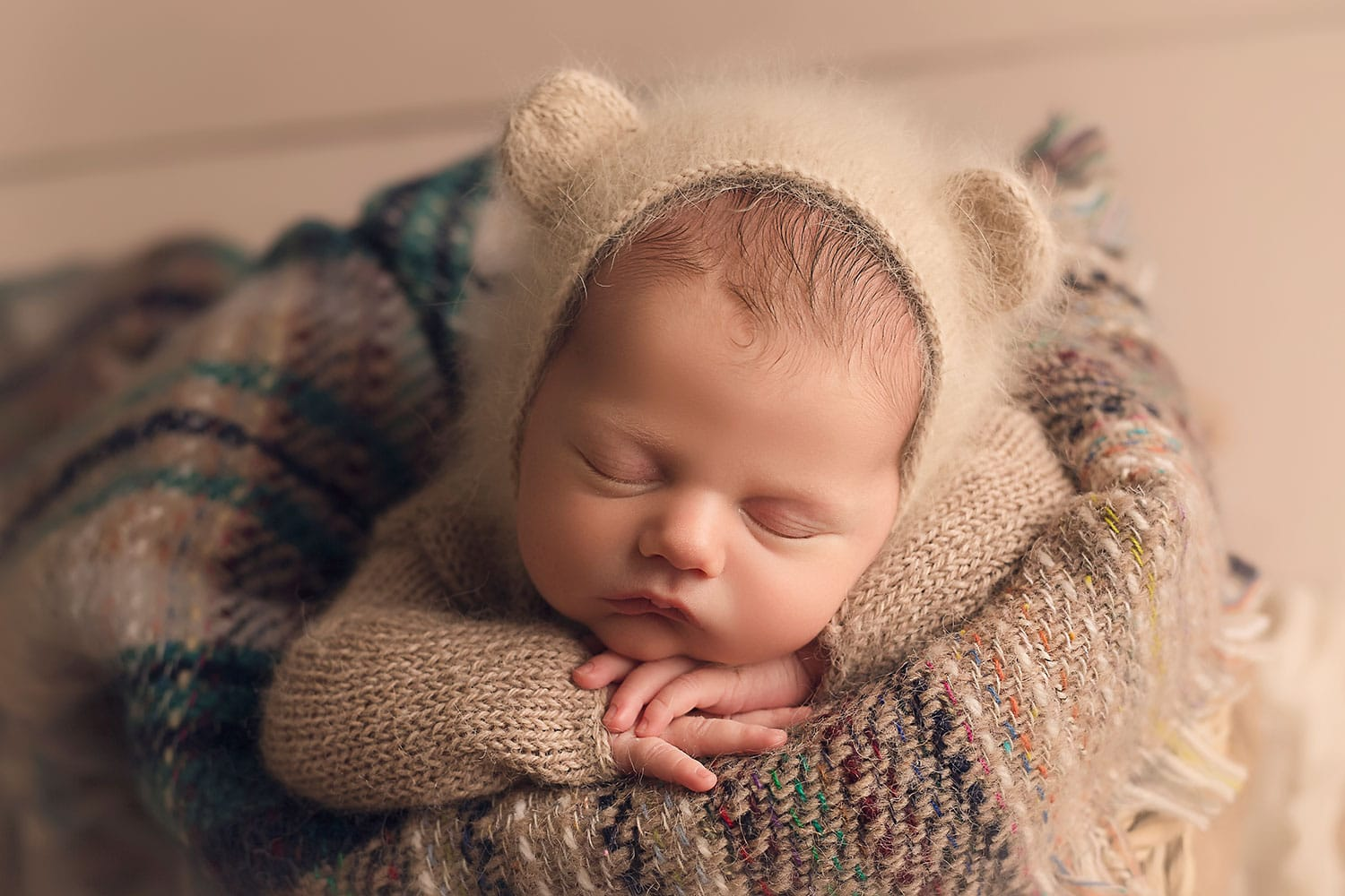 Newborn in bear bonnet by Annie Whitaker Photography