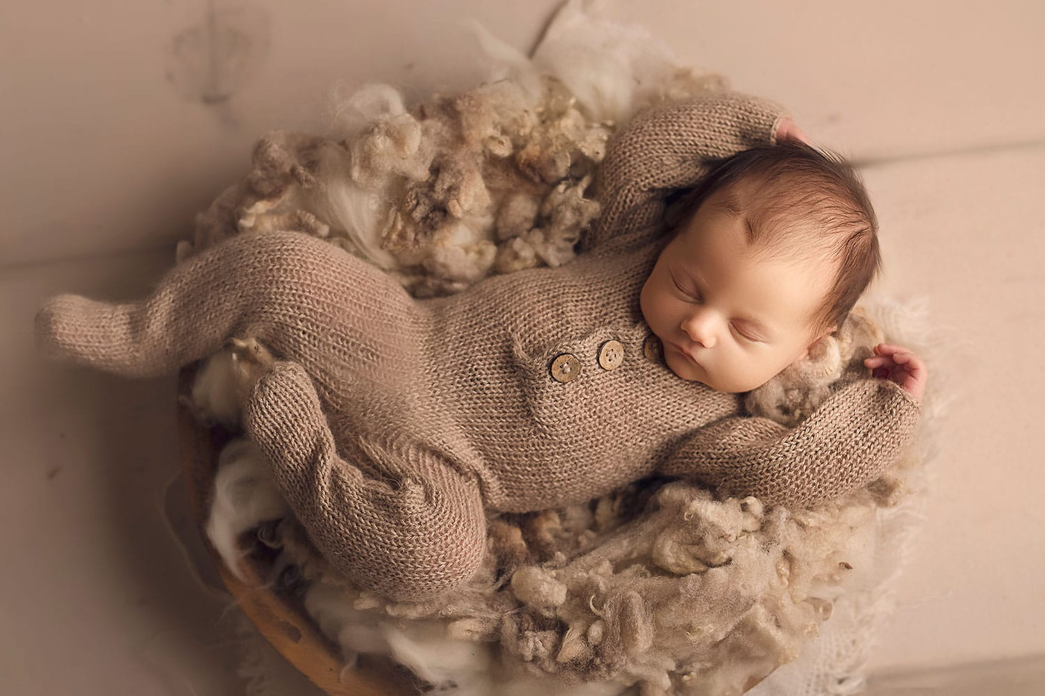 Baby boy stretched out in bowl by Annie Whitaker Photography
